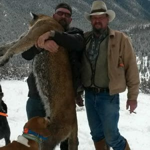 Hunter holding mountain lion
